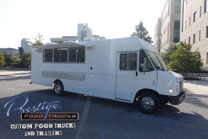 side view of white food truck with service window open