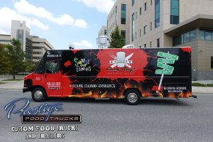 Savor Our Flavors food truck with flames graphics