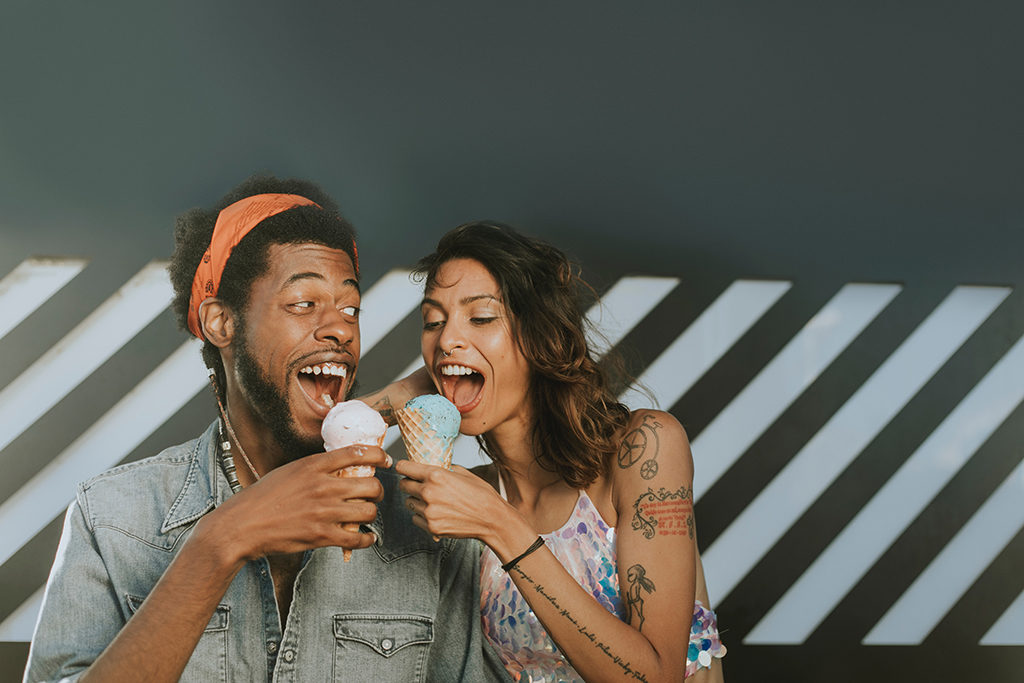 two people of color eating ice cream cones