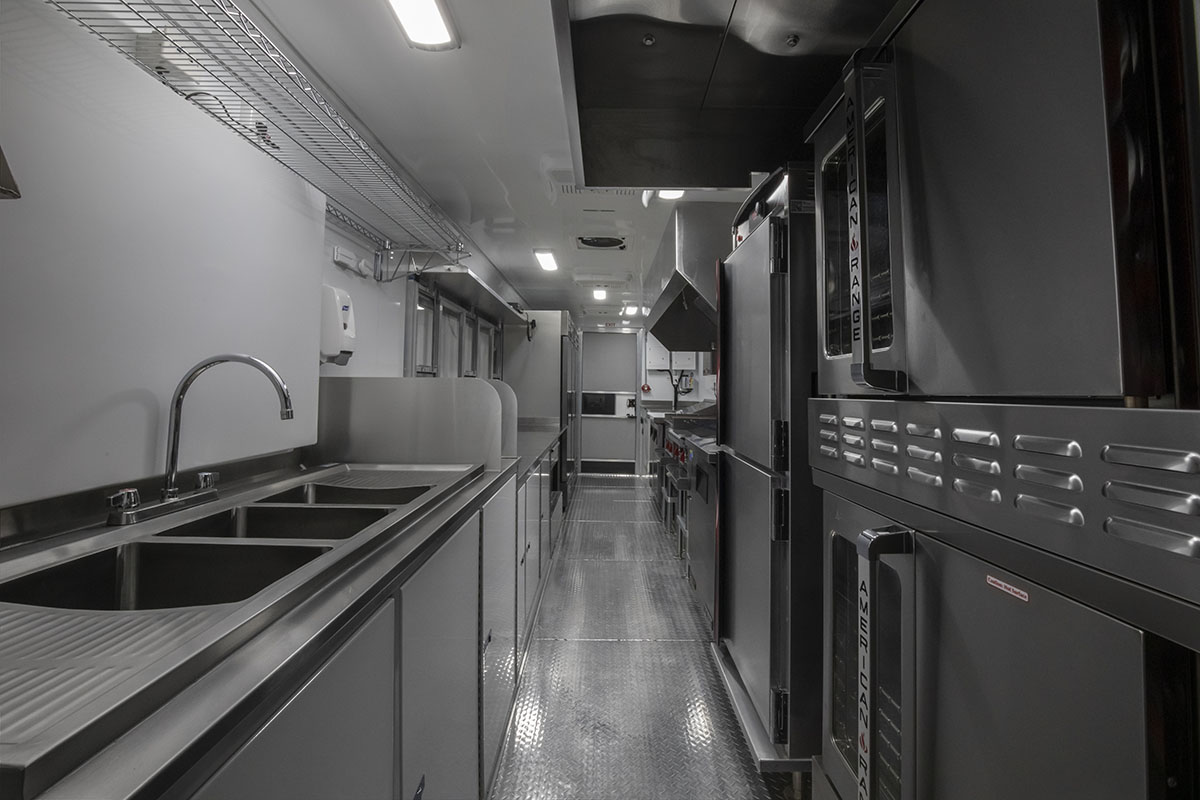 food truck interior kitchen photo showing sink and ovens